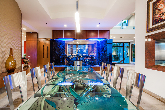 A wall-size aquarium is featured in the dining room. (COURTESY OF Shapiro & Sher Group)