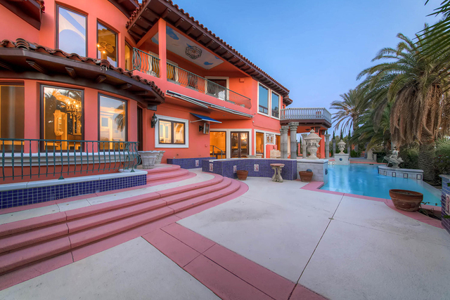 The mansion at 8801 Palm Greens Court is in Tournament Hills. It's listed by The Tom Love Group for nearly $4 million. (Courtesy)