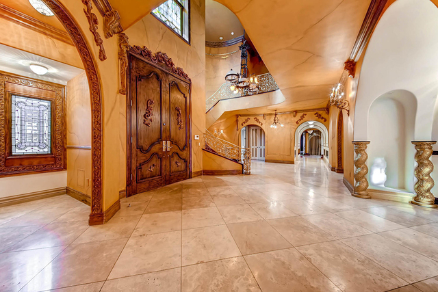 Nearly 20-foot-high entry doors open to the grand ballroom on the main floor of the house, which also includes a laundry room, butler pantry, chef's kitchen, bar with an indoor fountain, office  ...