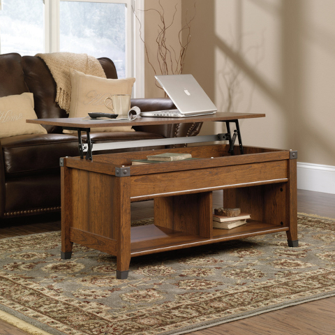COURTESY The Sauder Carson Forge Lift-Top Coffee Table is both versatile and unique, with a lift top that comes up and forward to create a work surface.