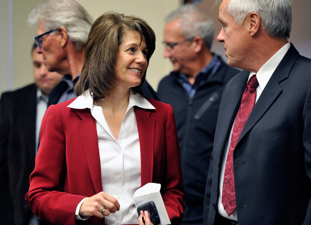 Catherine Cortez Masto, left, appears with chancellor Daniel Klaich at the Board of Regents meeting on Tuesday, Dec. 16, 2014, in Las Vegas. (David Becker/Las Vegas Review-Journal)