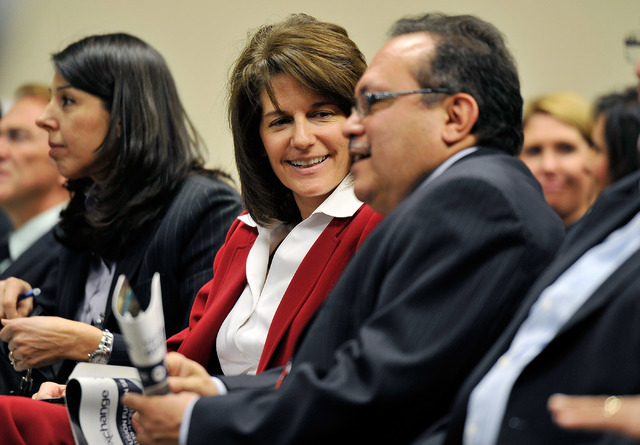 Catherine Cortez Masto, left, speaks with Jose Solorio of the latino Leadership Council before the Board of Regents meeting on Tuesday, Dec. 16, 2014, in Las Vegas. (David Becker/Las Vegas Review- ...