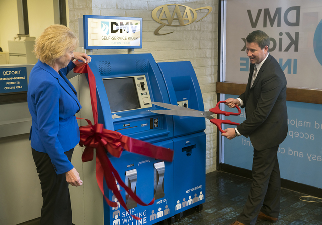 Terri Albertson, the director of the Nevada DMV, left, and Brian MacAdam, senior vice president of operations for AAA, participated in a ribbon-cutting ceremony for the next-generation DMV in a Bo ...