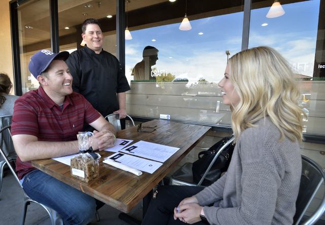 Chef and owner Jaret Blinn, background, talks with patrons Casey and Lauren Treese at Craft Kitchen. Bill Hughes/Las Vegas Review-Journal