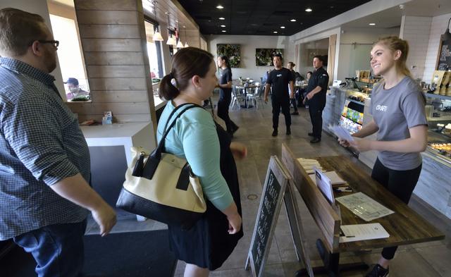 Hostess Kaycie Noble, right, greets customers at Craft Kitchen. Bill Hughes/Las Vegas Review-Journal