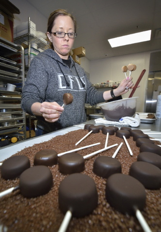 Katie Ward makes cheesecake lollipops dipped in chocolate and coated with chocolate Pop Rocks at Craft Kitchen. Bill Hughes/Las Vegas Review-Journal