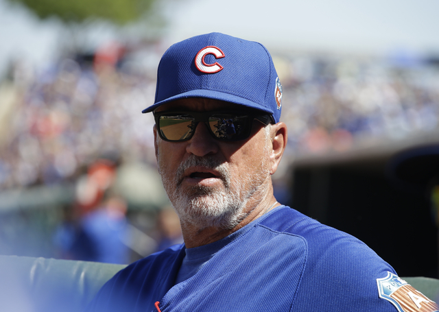 Chicago Cubs manager Joe Maddon watches during a spring training baseball game against the Kansas City Royals on Wednesday, March 16, 2016, in Surprise, Ariz. (AP Photo/Darron Cummings)