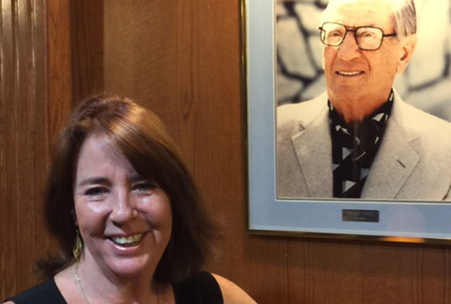 Suzanne Dalitz stands in front of a portrait of her late father, Moe Dalitz, at the Las Vegas Country Club. (Norm Clarke/Las Vegas Review-Journal)