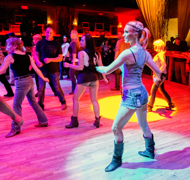 Daisy, not her real name, line dances at Revolver Saloon & Dance Hall at Santa Fe Station on Wednesday, Feb. 23, 2016. Jeff Scheid/Las Vegas Review-Journal Follow @jlscheid