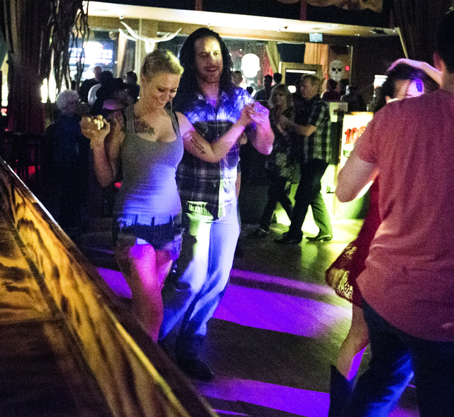 Daisy, not her real name, and her dance partner Jonathan Barrett dance at Revolver Saloon & Dance Hall at Santa Fe Station on Wednesday, Feb. 23, 2016. Jeff Scheid/Las Vegas Review-Journal Fol ...