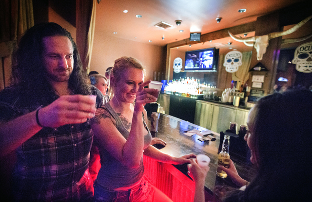 Daisy, not her real name, center, Jonathan Barrett, and Brittany Gray have a shot at Revolver Saloon & Dance Hall at Santa Fe Station on Wednesday, Feb. 23, 2016. Jeff Scheid/Las Vegas Review- ...
