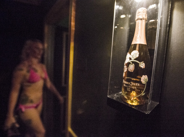 Daisy, her stage name, walks into one of the champagne themed rooms at  Sapphire Gentleman's Club, 3025 Sammy Davis Jr. Drive on Friday, Feb. 26, 2016. Jeff Scheid/Las Vegas Review-Journal Follow  ...