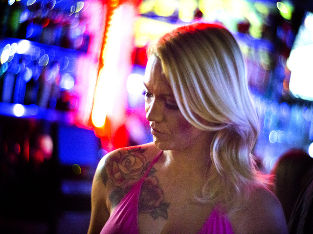 Daisy, her stage name, stands a one of the bars at  Sapphire Gentleman's Club, 3025 Sammy Davis Jr. Drive on Friday, Feb. 26, 2016. Jeff Scheid/Las Vegas Review-Journal Follow @jlscheid