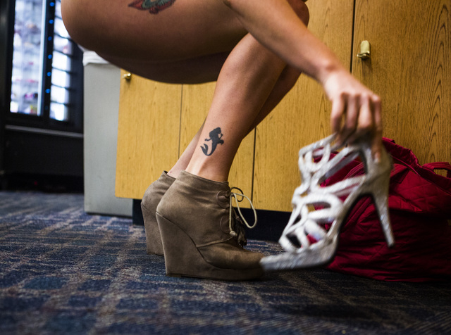 Daisy, her stage name, holds a high heal shoe while in the dressing room at  Sapphire Gentleman's Club, 3025 Sammy Davis Jr. Drive on Friday, Feb. 26, 2016. Jeff Scheid/Las Vegas Review-Journal Fo ...