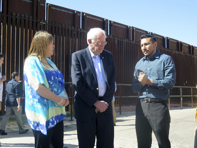 Bernie Sanders and his wife Jane speak with a young immigrant named Julio Zuniga who told him about his struggles in this country after being brought here illegally by his family, after a Sanders  ...