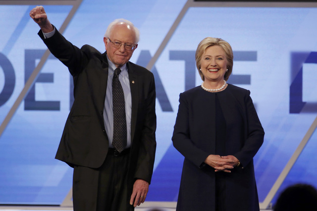 Democratic U.S. presidential candidates Senator Bernie Sanders and Hillary Clinton pose before the start of the Univision News and Washington Post Democratic U.S. presidential candidates debate in ...