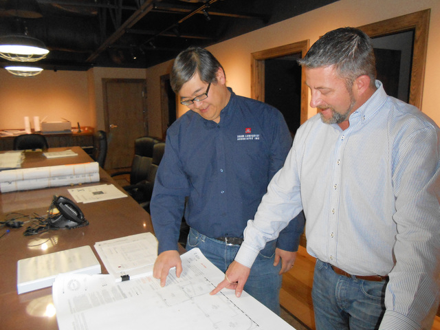 Chris Rowe and Holden Hsiao, vice president of Shaw-Lundquist Associates, look over blueprints Jan. 11, 2016, of current projects at company headquarters, 5662 Las Costa Canyon Court. Linda J. Sim ...