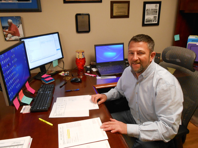 Chris Rowe, managing director of Shaw-Lundquist Associates construction company, is shown in his office Jan. 11. Linda J. Simpson/Special to View