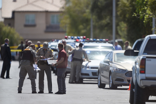 Police investigate a shooting on Fast Elk Street in Northwest Las Vegas, where two people were found dead, that ended with a suspect being shot and police K9 Nicky being shot and killed Thursday,  ...