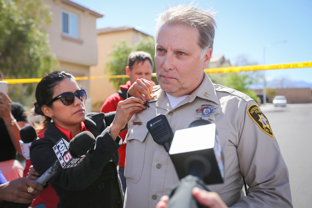 Las Vegas Metro Capt. Shawn Andersen prepares to give a briefing to news media regarding a shooting on Fast Elk Street in Northwest Las Vegas, where two people were found dead, that ended with a s ...