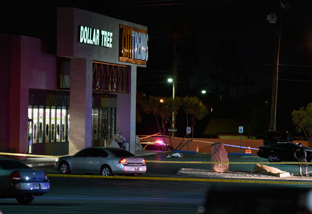 A body is cover in the parking lot as Las Vegas police investigate in the 3000 block of East Tropicana Avenue Friday, March 25, 2016, in Las Vegas. David Becker/Las Vegas Review-Journal Follow @da ...