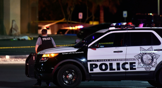 A body is cover in the parking lot as Las Vegas police investigate in the 3000 block of East Tropicana Avenue Friday, March 25, 2016, in Las Vegas. (David Becker/Las Vegas Review-Journal) Follow @ ...