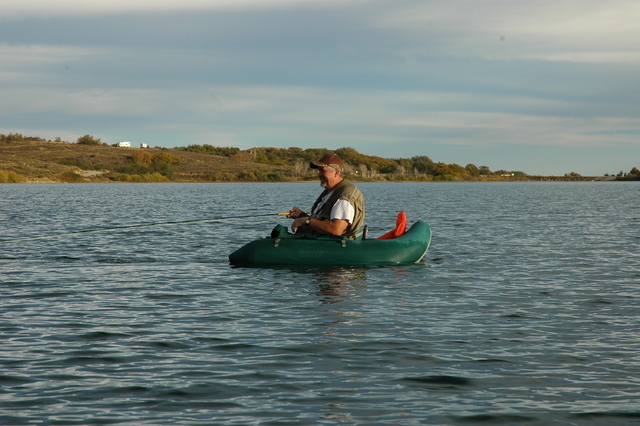 Don Nash kicks his V-shaped pontoon while fishing for trout at Utah's Kolob Reservoir. Photo by Doug Nielsen