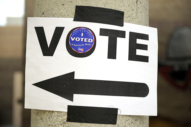 """A directional sign is embellished with an """"I voted"""" sticker at Del E. Webb Middle School in Anthem on Tuesday, June 10, 2014. (Mark Damon/Las Vegas Review-Journal)"""