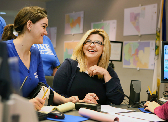 Assemblywoman Michele Fiore, R-Nev., right, shares a laugh with her executive assistant, Cassidy McGowan, while filing at the Clark County Government Center to run for the 3rd Congressional Distri ...