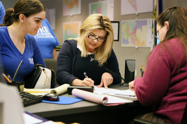 Assemblywoman Michele Fiore, R-Nev., center, files paperwork with Sonia Grive, right, at the Clark County Government Center to run for the 3rd Congressional District Wednesday, March 9, 2016, in L ...