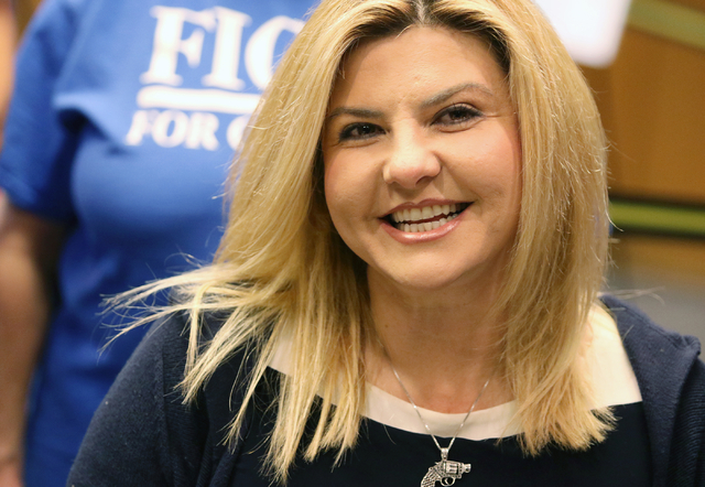 Assemblywoman Michele Fiore, R-Nev., socializes while filing at the Clark County Government Center to run for the 3rd Congressional District Wednesday, March 9, 2016, in Las Vegas. (Ronda Churchil ...