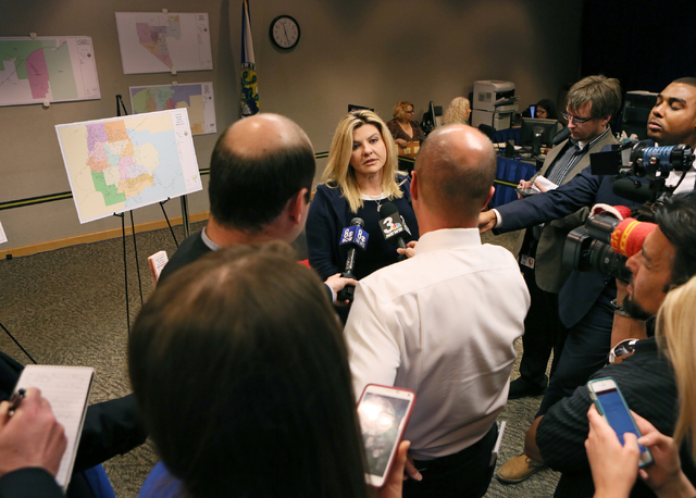 Assemblywoman Michele Fiore, R-Nev., center, speaks to the news media after filing paperwork at the Clark County Government Center to run for the 3rd Congressional District Wednesday, March 9, 201 ...