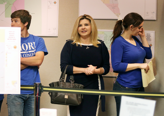Assemblywoman Michele Fiore, R-Nev., center, waits in line to file paperwork at the Clark County Government Center to run for the 3rd Congressional District Wednesday, March 9, 2016, in Las Vegas. ...