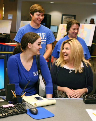 Assemblywoman Michele Fiore, R-Nev., front right, shares a laugh with her executive assistant Cassidy McGowan, front left, while filing at the Clark County Government Center to run for the 3rd Con ...