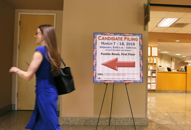 A woman walks past a sign for candidate filing at the Clark County Government Center Wednesday, March 9, 2016, in Las Vegas. Ronda Churchill/Las Vegas Review-Journal