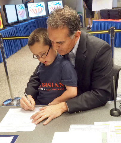 Republican Danny Tarkanian files as a candidate for Congressional District 3 with his son Jerry, 6, on his lap at the Clark County Government Center in Las Vegas, Thursday, March 10, 2016. Jerry H ...