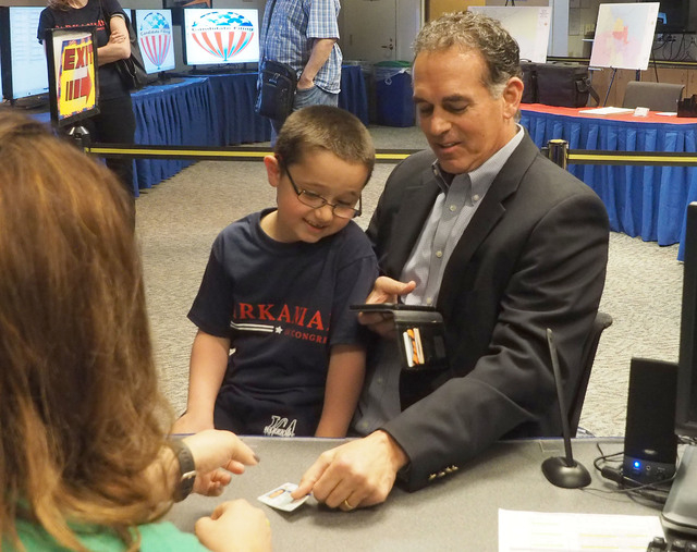 Republican Danny Tarkanian shows his identification as he files as a candidate for Congressional District 3 with his son Jerry, 6, on his lap at the Clark County Government Center in Las Vegas, Th ...