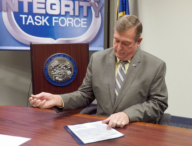 U.S. Rep. Cresent Hardy, R-Nev., signs the forms to file to run for re-election to his Congressional District 4 at the Secretary of State's office in the Grant Sawyer Building in Las Vegas, Friday ...