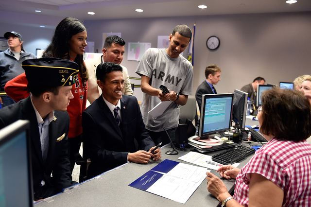 Reuben D'Silva, third from left, surrounded by family and supporters, smiles as he files to run for the 1st Congressional District at the Clark County Government Center Friday, March 18, 2016, in  ...