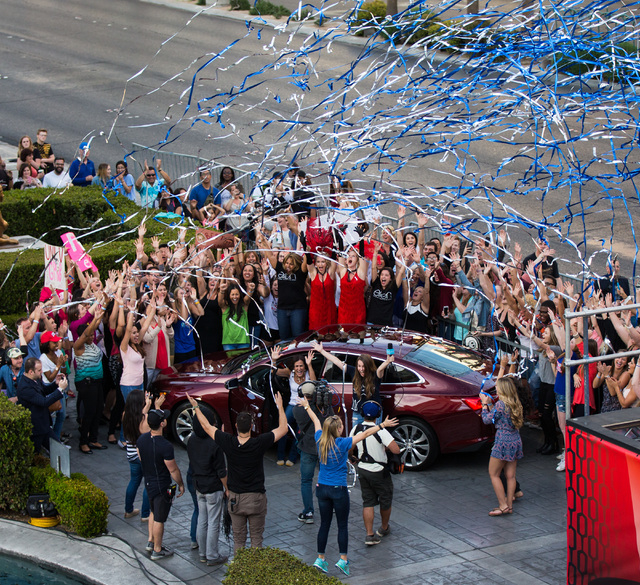 "Donna Kalbfleisch of Las Vegas, lower center, in car, reacts after winning a new Chevrolet Malibu in a contest for the taping of a segment of ""The Ellen DeGeneres Show"" outside o ..."