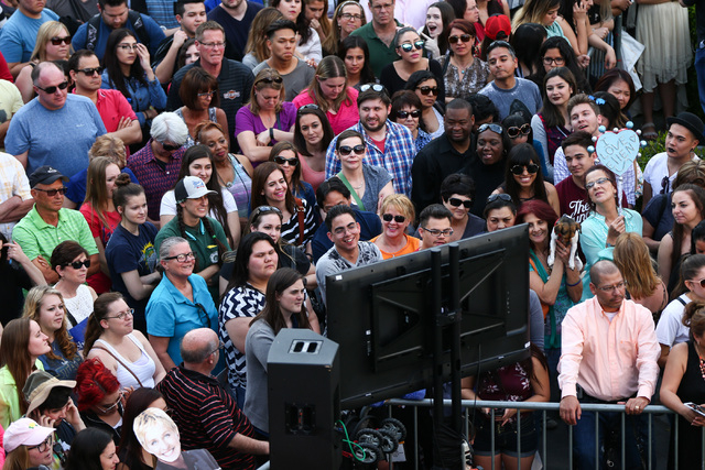 "People watch a TV screen during the taping of a segment of ""The Ellen DeGeneres Show"" outside of Caesars Palace in Las Vegas on Tuesday, March 1, 2016. Chase Stevens/Las Vegas Re ..."