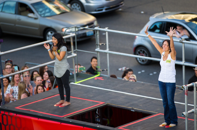"Priscilla Martinez of Los Angeles, left, and Donna Kalbfleisch of Las Vegas react they compete in a contest for the taping of a segment of ""The Ellen DeGeneres Show"" outside of C ..."