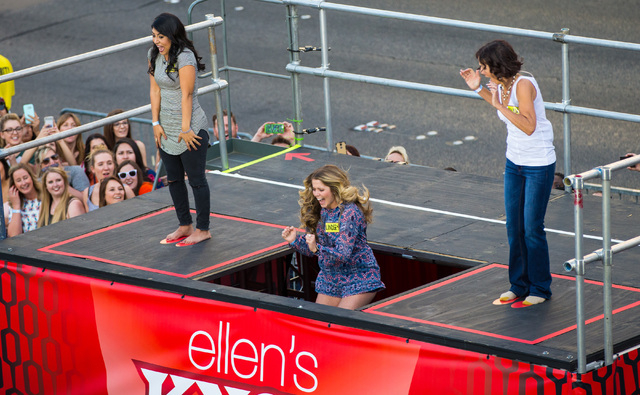 Linsdey West of Bowling Green, Ky., center, falls as Priscilla Martinez of Los Angeles, left, and Donna Kalbfleisch of Las Vegas look on as they compete in a contest for the taping of a segment of ...