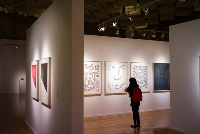 UNLV freshman Kamryn Cruz looks at a series of lithographs -- depicting Ellsworth Kelly's husband Jack Shear -- in the Ellsworth Kelly exhibition now at UNLV's Barrick Museum. Chase Stevens/Las Ve ...