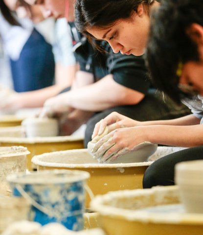 Ceramics student Brenda Roles forms the sides to a new ceramic bowl she is making for the Empty Bowl event while in class at Green Valley High School Feb. 20, 2015. View file photo