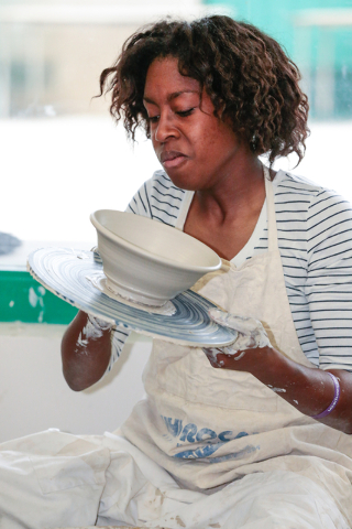 Ceramics student, Eboni Thomas, inspects her recent creation of ceramic bowl she made for the Empty Bowl event while in class at Green Valley High School Feb. 20, 2015. View file photo