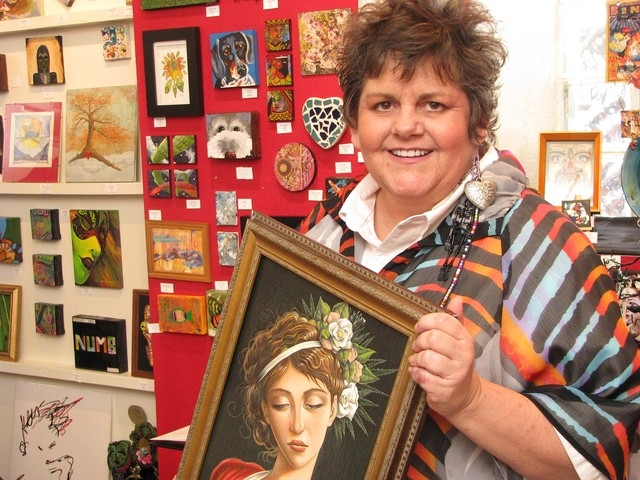 Artist and gallery owner Jana Lynch is shown at the former location of her gallery Jana's RedRoom Aug. 20, 2014. The new, larger gallery is down the hall in The Arts Factory, 107 E. Charleston Blv ...