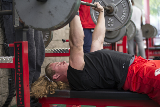 UNLV's Kimble Jensen warms up for the bench press challenge during Pro Day at UNLV's Lied Athletic Complex on Thursday, March 17, 2016, in Las Vegas. Erik Verduzco/Las Vegas Review-Journal Follow  ...