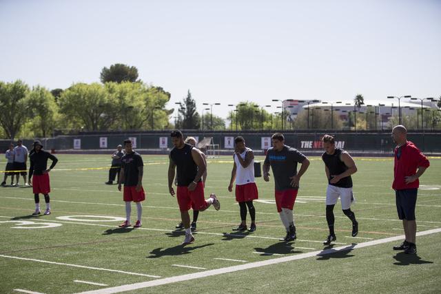 Players warm up before running the 40 yard dash during Pro Day at UNLV's Rebel Park on Thursday, March 17, 2016, in Las Vegas. Erik Verduzco/Las Vegas Review-Journal Follow @Erik_Verduzco