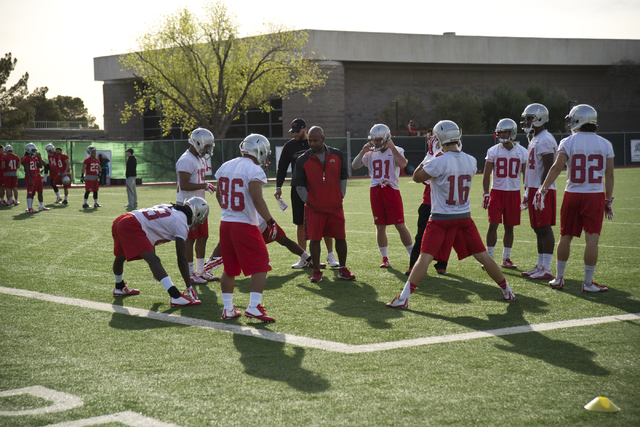 Players on the UNLV football team stretch during the first day of spring practice at the Rebel Park practice fields on the UNLV campus in Las Vegas on Monday, March 7, 2016. Daniel Clark/Las Vegas ...